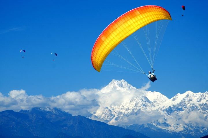 Mountain range view tandem paragliding flight
